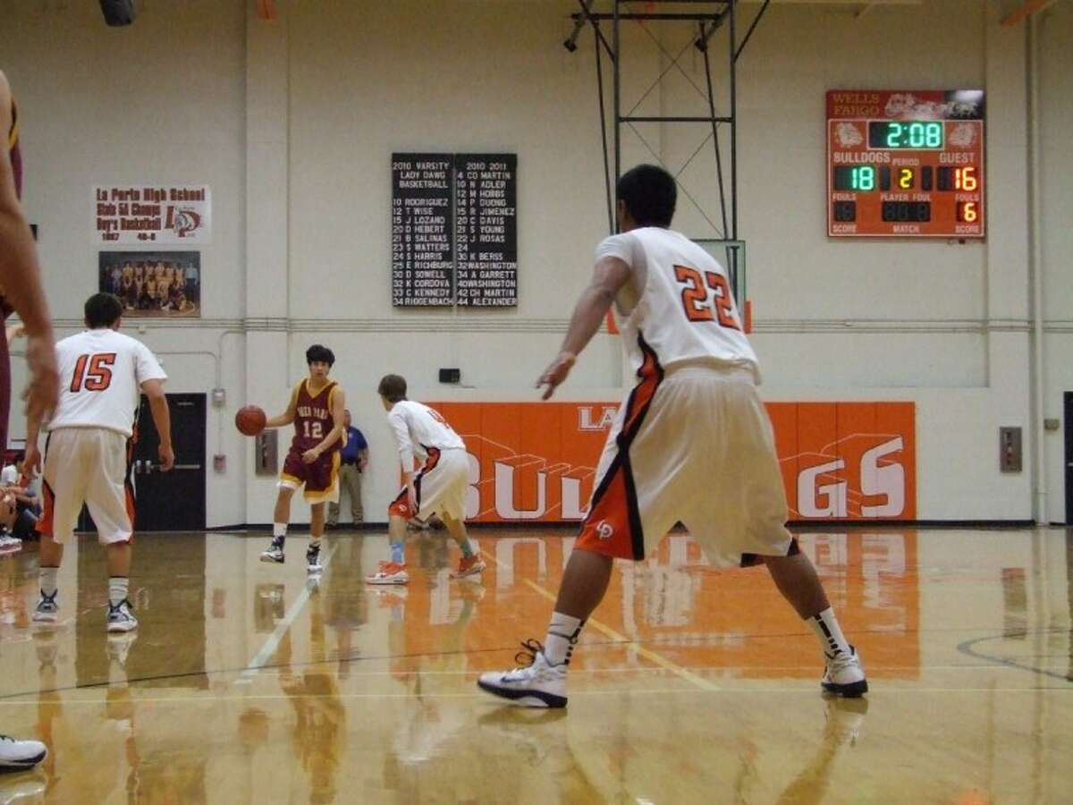 Robert Martinez looks for a way to score with La Porte players surrounding him in last week's non-district play. The Deer took the game 46-43 in La Porte.