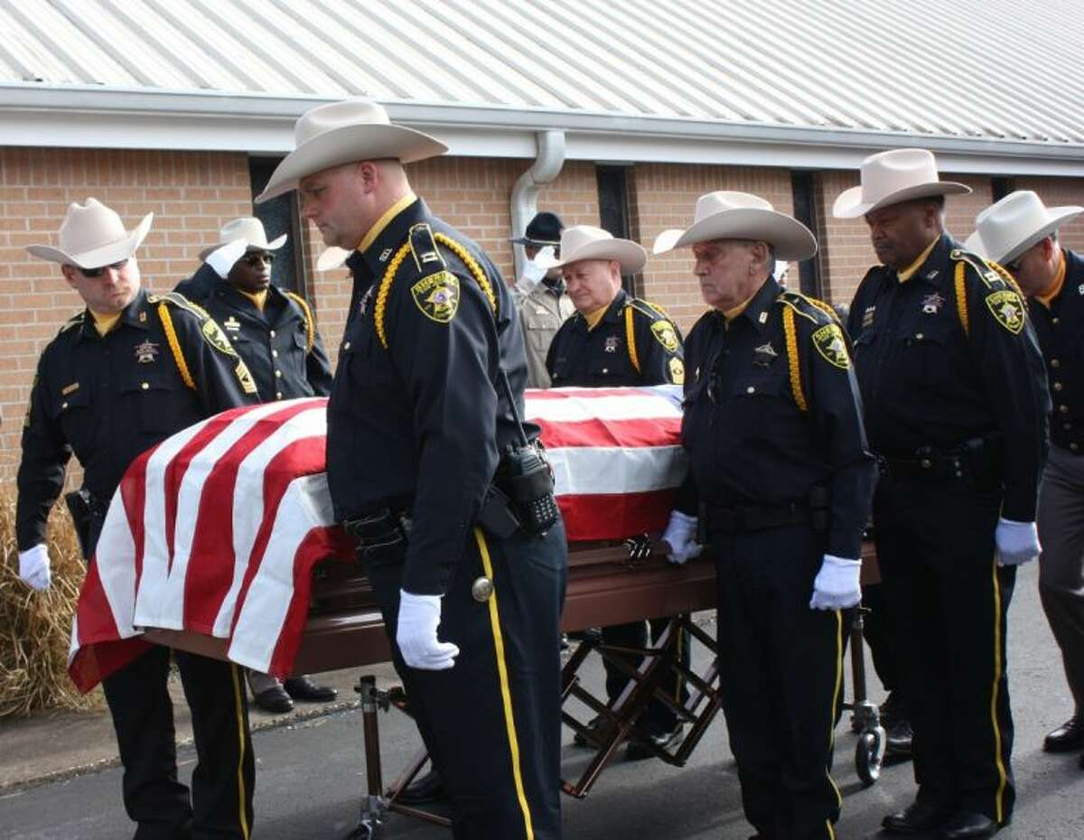 Close friends such as Chief Deputy Robert Long, center in front row, served as pallbearers for the funeral service for Sheriff James Lewis Walters on Jan. 11.