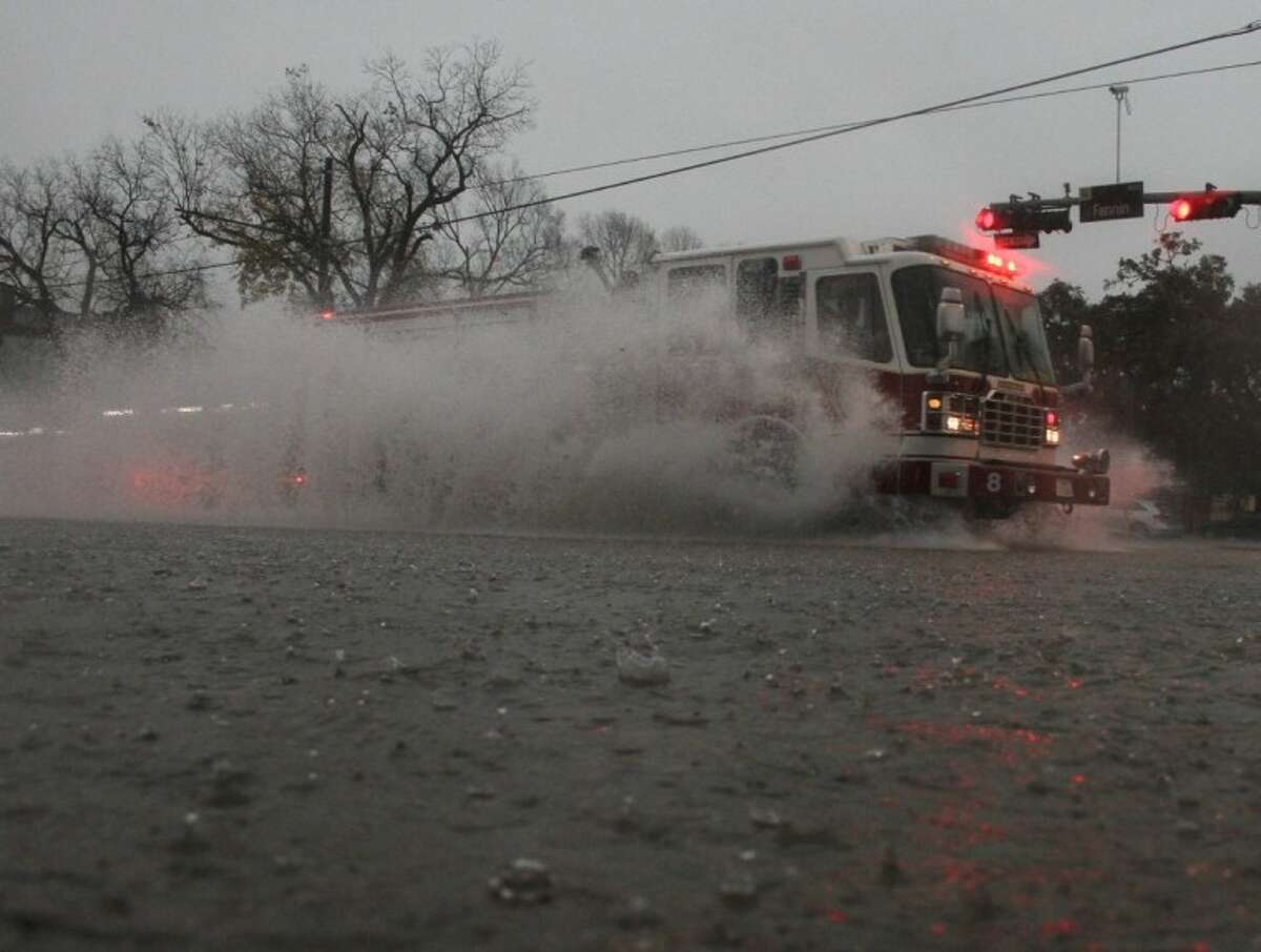 A firetruck passes through high water at the intersection of Fannin and Main Streets in the Texas Medical Center area Monday. Numerous rescues of motorists in high water were being reported, and drivers are being encouraged to stay off the streets unless their trip is an absolute emergency.