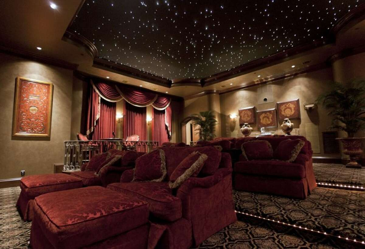 The movie theater at 88 Grand Regency Circe in The Woodlands, also known as DanMar Manor. The home is the largest in Carlton Woods at over 30,000 sq./ft and has been listed for 19-million.