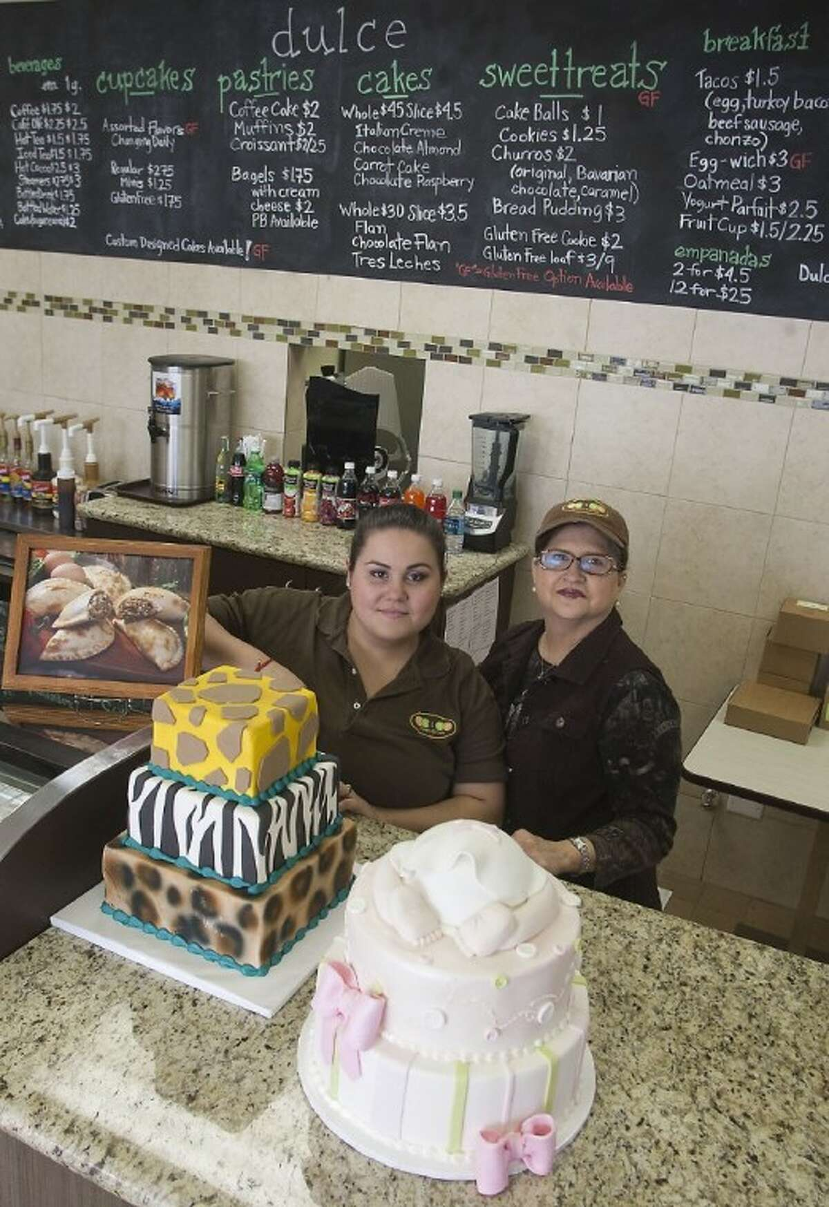 Photo by PATRIC SCHNEIDER/The RancherChef Cristina Gutierrez prepares custom-decorated cakes for Dulcé Bakery and Café while her mother, Priscilla Vazquez makes specialty coffee drinks from homemade recipes.