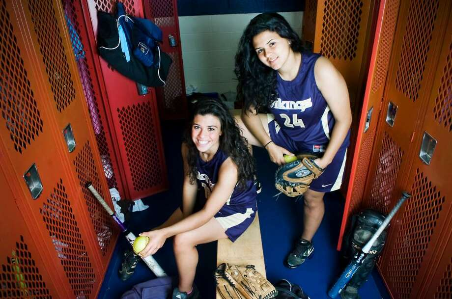 Kaitlyn Della Jacono and Casey Correa, the pitcher and catcher on the King softball team, are finishing up their last season together and have been friends since the second grade.   The are photographed in the King locker room on Tuesday May 4, 2010 on Stamford, Conn. Photo: Katheen O'Rourke / Stamford Advocate