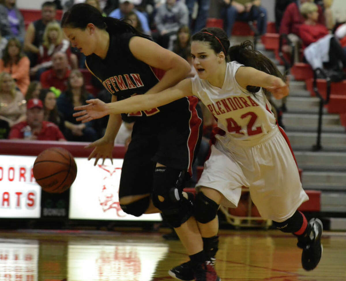 Frankie York (42) and Christina Bardwell (22) dive for a loose ball near midcourt late in the fourth quarter of Splendora's 45-38 win over Huffman on Jan. 11, 2013, at Splendora High School.