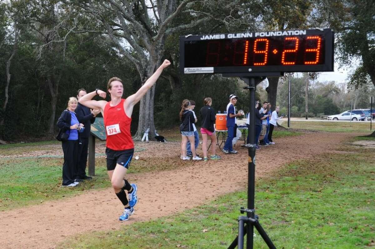 Forest Bell celebrates as he finishes the Assisteens of the Bay Area first annual 5K run in second place Saturday, Jan. 7.