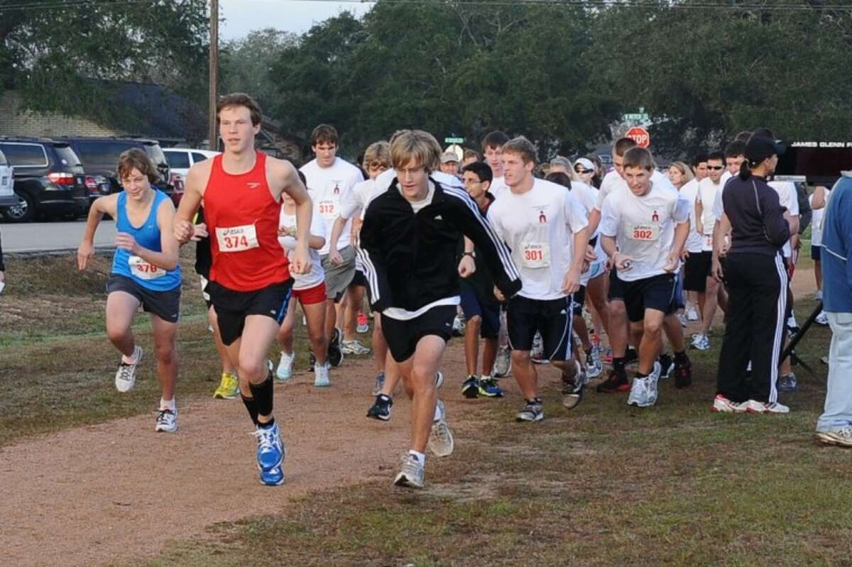 Left to right, Zachary Dwyer, Forest Bell and Corey Zimpher lead the pack as the Assisteens of the Bay Area first annual 5K run gets under way Saturday, Jan. 7.
