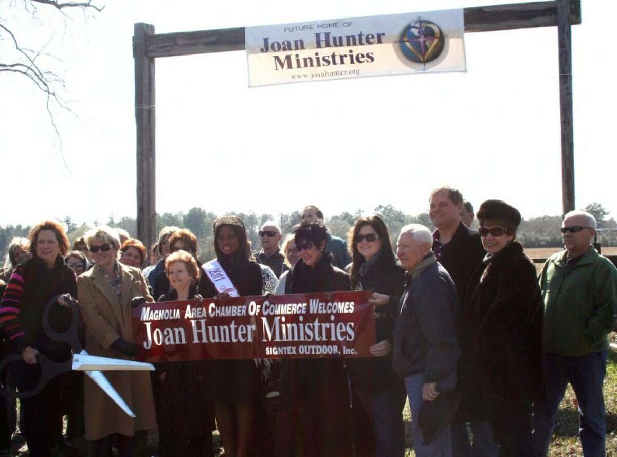 Members of the community show for Joan Hunter Ministries ribbon cutting. Joan Hunter said she hopes to have the facility's grand opening in mid October of this year, even though they need about $1 million in donations.