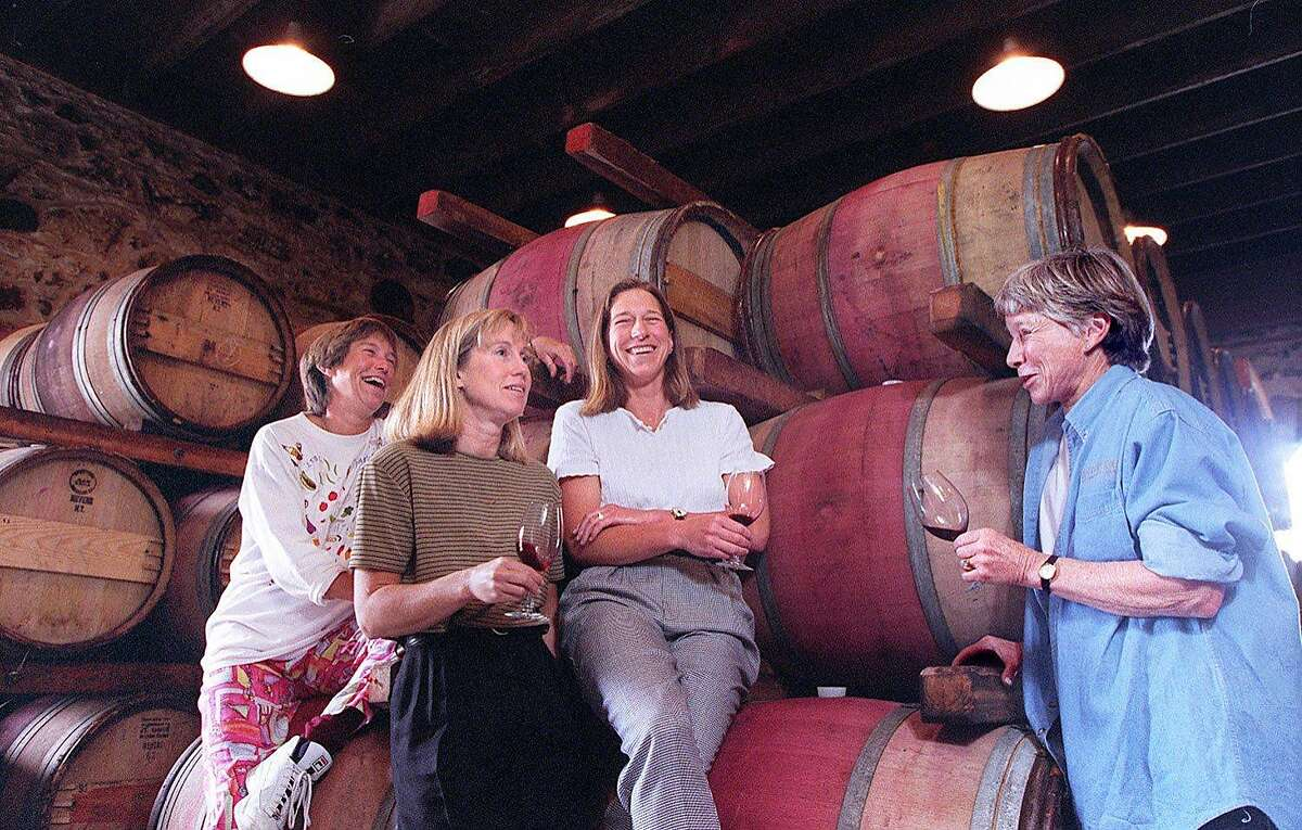 SPOTTSWOODE 3/C/29APR97/FD/CS - The Novak family in the stone storeroom of the Spottswoode Winery in St. Helena. Daughters Kelley (L), Lindy and Beth. At right is mom, Mary. SAN FRANCISCO CHRONICLE PHOTO BY CHRIS STEWART