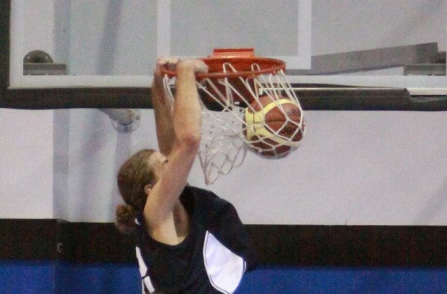 """6' 9"""" Russell Permenter dunks this shot for the Havok against the Texas Cyclones. Permenter was a force on the boards, capturing 11 rebounds — 5 offensive — en route to a 104-87 rout of the Texas Cyclones."""