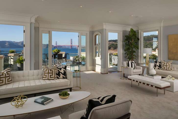 French doors off the living room open to a view terrace.