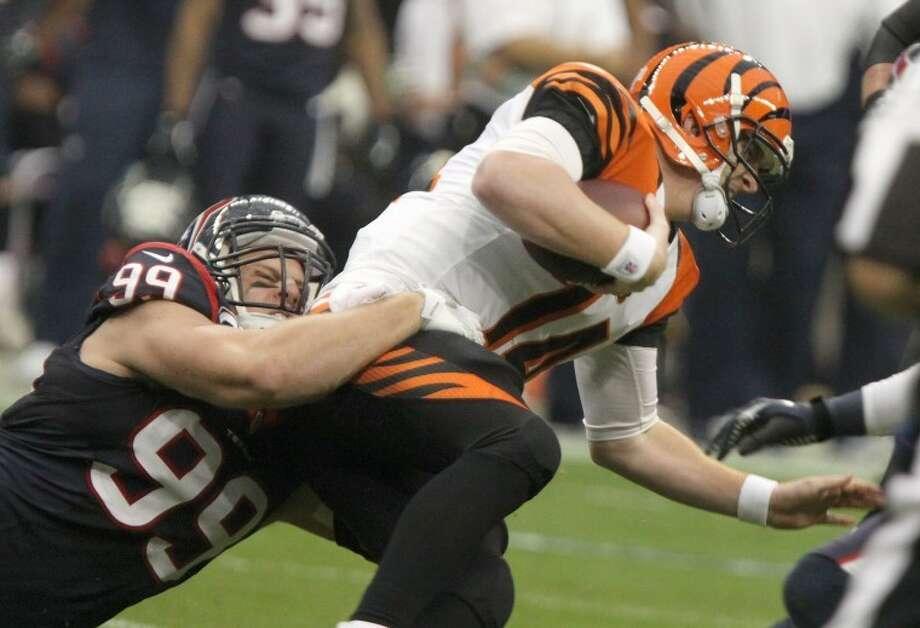 Houston Texans' J. J. Watt sacks Cincinnati Bengals quarterback Andy Dalton during the Texans' 19-13 victory Jan. 5 at Reliant Stadium. Dalton, a Katy High School graduate, was held to 127 passing yards in his postseason return to Houston.