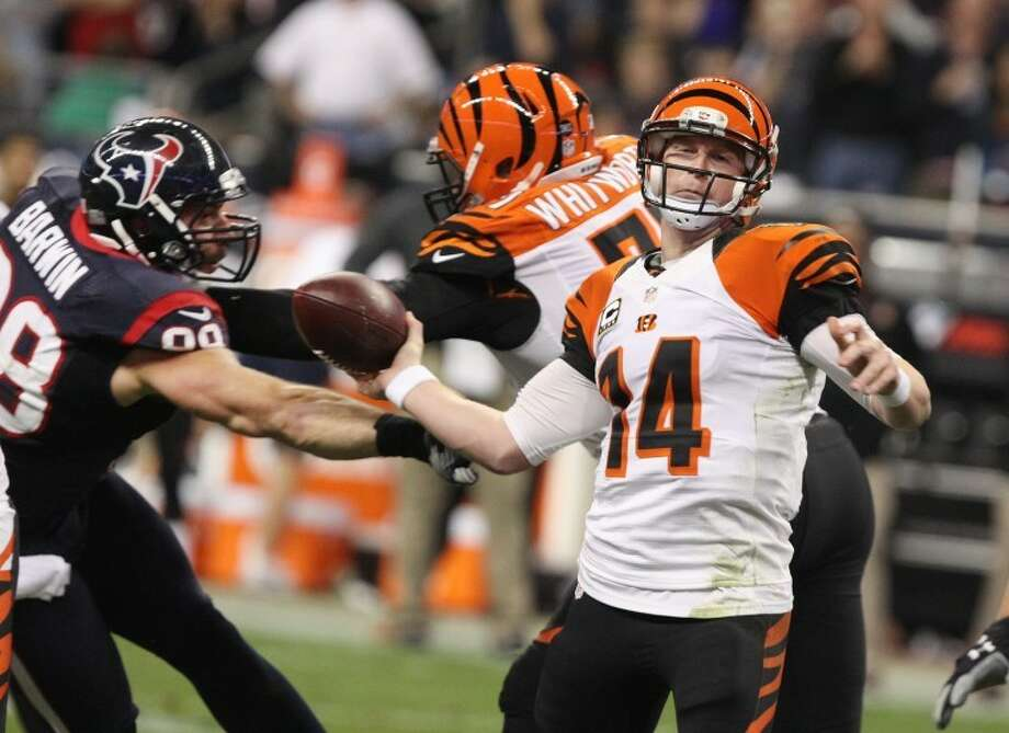 Houston Texans' Connor Barwin hits the throwing arm of Cincinnati Bengals' Andy Dalton in their AFC Wild Card Playoff Jan. 5 at Reliant Stadium. Photo: Alan Warren/HCN