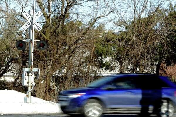 A railroad crossing for the Waterbury line runs across Pershing Drive in Ansonia, Conn. Thursday, Feb. 5, 2015.