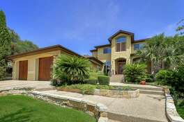 This custom-built home at 18114 Liscum Hill in Rogers Ranch spans 4,385 square feet and holds five bedrooms, five full bathrooms and one half bathroom.