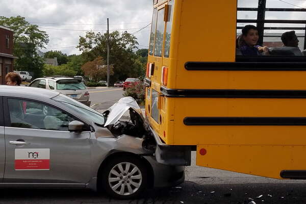 A car crashed into a school bus on Main Street in Danbury.