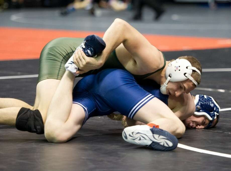 Strake Jesuit senior Marc Henning returns to the UIL state meet in the 120-pound class along with teammate Sam Speer (160) and Bellaire's Devon Jackson (106). Photo: Kevin B Long