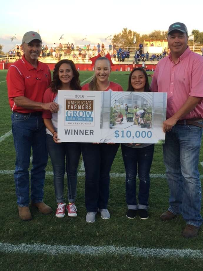 Lockney ISD is the recipient of a 2016 America's Farmers Grow Rural Education Grant for $10,000 from the Monsanto Fund. Announcing the grant at a recent football game are Lockney ISD Superintendent Phil Cotham (left), Lockney High students Alyssa Barretero and Mackenzy and Monsanto District Sales Manager Chad Cook.