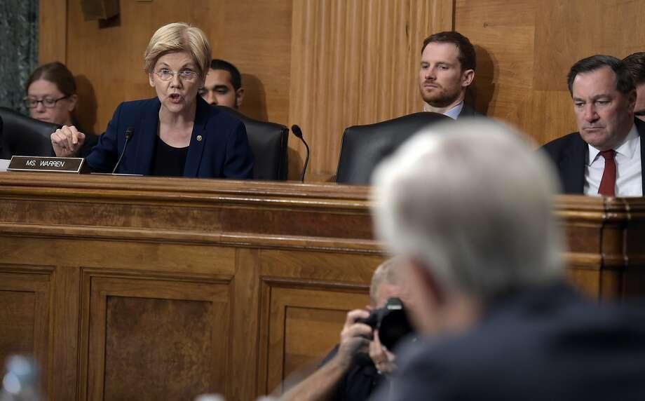Sen. Elizabeth Warren, D-Mass., questions Wells Fargo CEO John Stumpf about bogus accounts at the Banking Committee hearing last week. Photo: Susan Walsh, Associated Press