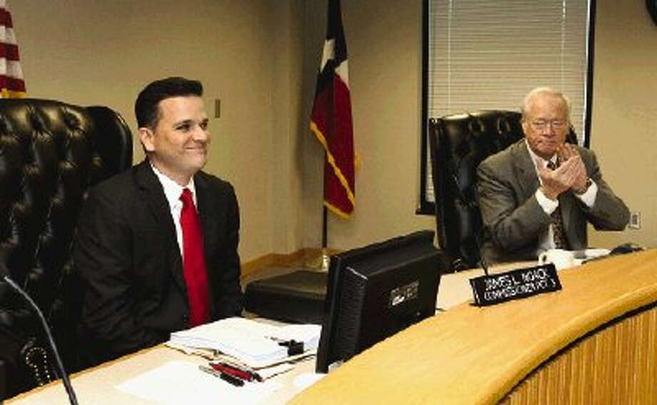 Montgomery County Judge Alan B. Sadler, right, welcomes new Precinct 3 Commissioner James Noack to his first Commissioners Court meeting following his swearing in Jan. 1.
