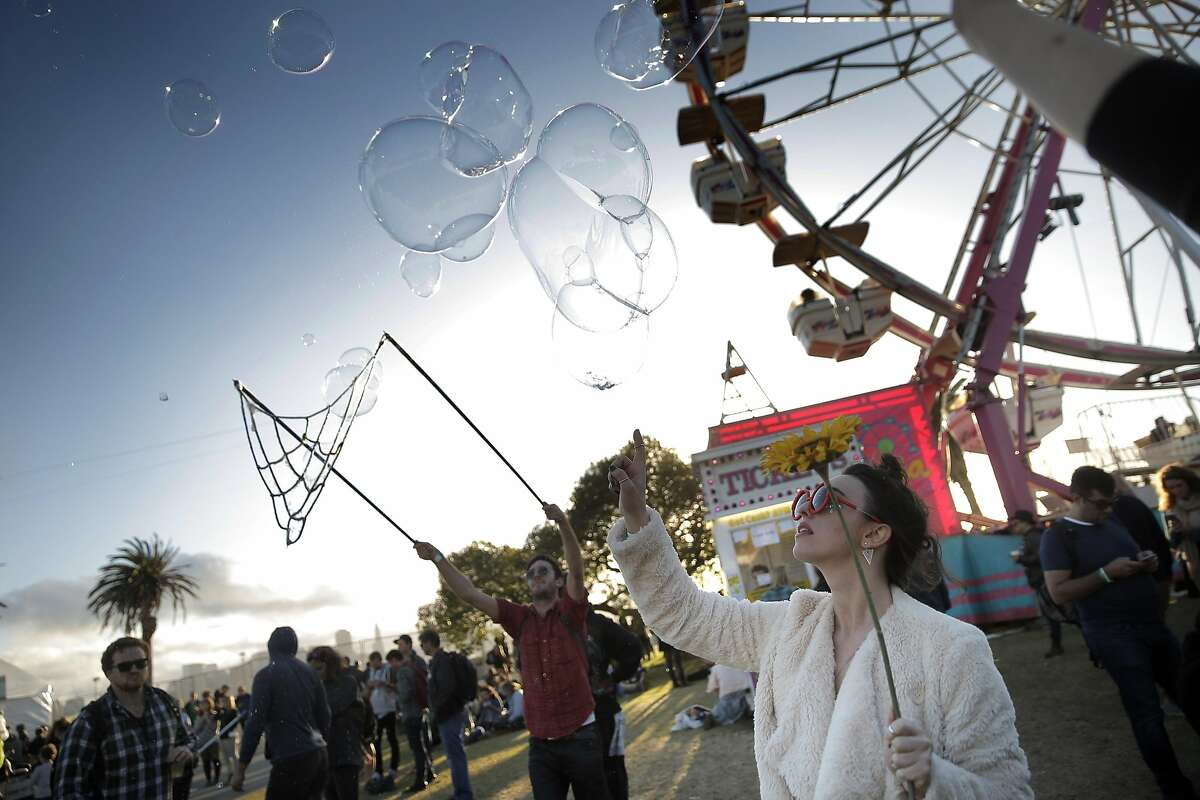 Flower Hits the Big Time waits for bubbles to come down during the Treasure Island Music Festival on Treasure Island, in San Francisco, Calif., on Sunday, October 18, 2015.