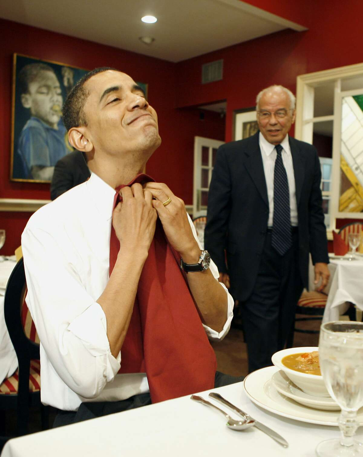 US Democratic presidential candidate Illinois Senator Barack Obama puts on a napkin while eating gumbo with the Chairman of Louisiana Recovery Authority Dr Norman Francis (R) during his visit of Dooky Chase restaurant in New Orleans, Louisiana, February 7, 2008. Obama was in New Orleans, ahead of Louisiana's primary on February 9, and said the aftermath of Hurricane Katrina which ravaged the city in 2005 was a metaphor for a broken US government. AFP PHOTO/EMMANUEL DUNAND (Photo credit should read EMMANUEL DUNAND/AFP/Getty Images)