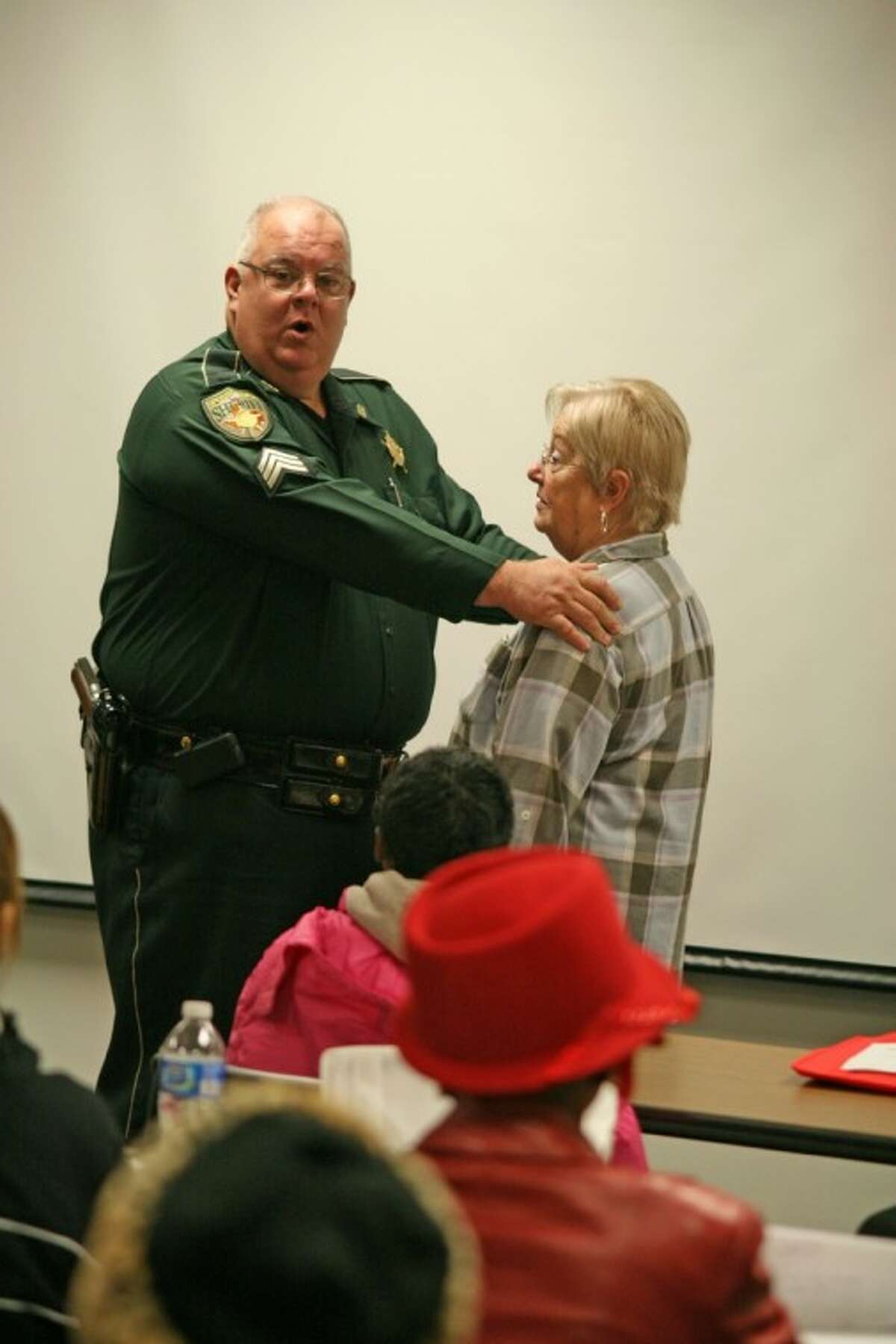 Galveston County Sheriff's Deputy Jimmie Gillane, left, taught a self-defense seminar during the Winter 55+ Health and Wellness Expo on Friday morning at COM Gymnasium. Margaret Dale of Bayou Vista, right, was one of the volunteers during the seminar.