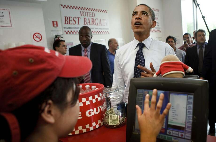 May 2009: President Obama orders a burger at a Five Guys restaurant in Washington, D.C. Photo: BRENDAN SMIALOWSKI, VIA BLOOMBERG NEWS