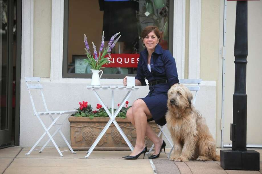 Sheri Falk and her dog, Tonto, at Basiques in Houston's Uptown. After spending time in France, Falk develped the Basiques clothing line which offers a timeless collection based on the French commitment to quality, simplicity, and elegance. (Photo by Alan Warren) Photo: Photo By Alan Warren