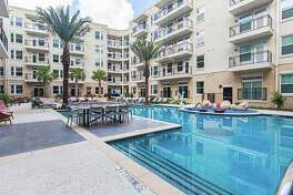 A resort style swimming pool is one of the amenities at the Post at Afton Oaks apartments.