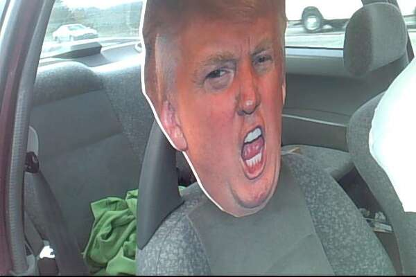 State troopers pulled over an HOV-lane violator Tuesday morning on state Route 167 in Auburn for trying to pass a cardboard cutout of presidential candidate Donald Trump's head as a passenger.