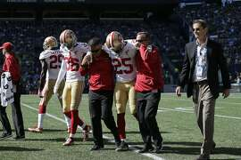 San Francisco 49ers' Jimmie Ward (25) is helped off the field with an injury after a play in the first half of an NFL football game against the Seattle Seahawks, Sunday, Sept. 25, 2016, in Seattle. (AP Photo/John Froschauer)