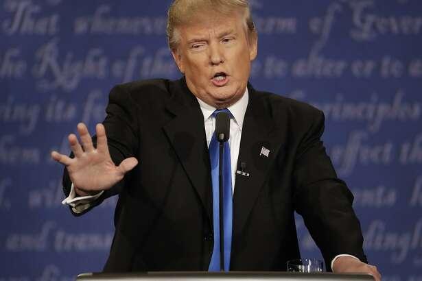FILE - In this Sept. 26, 2016 file photo, Republican presidential nominee Donald Trump speaks during the presidential debate at Hofstra University in Hempstead, N.Y.  (AP Photo/Patrick Semansky, File)