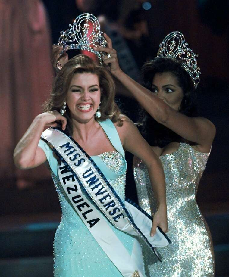 FILE - In this May 17, 1996, file photo, the new Miss Universe Alicia Machado of Venezuela reacts as she is crowned by the 1995 winner Chelsi Smith at the Miss Universe competition in Las Vegas. Machado became a topic of conversation during the first presidential debate between Republican nominee Donald Trump and Democratic candidate Hillary Clinton on Sept. 27, 2016. (AP Photo/Eric Draper, File) Photo: Eric Draper, Associated Press