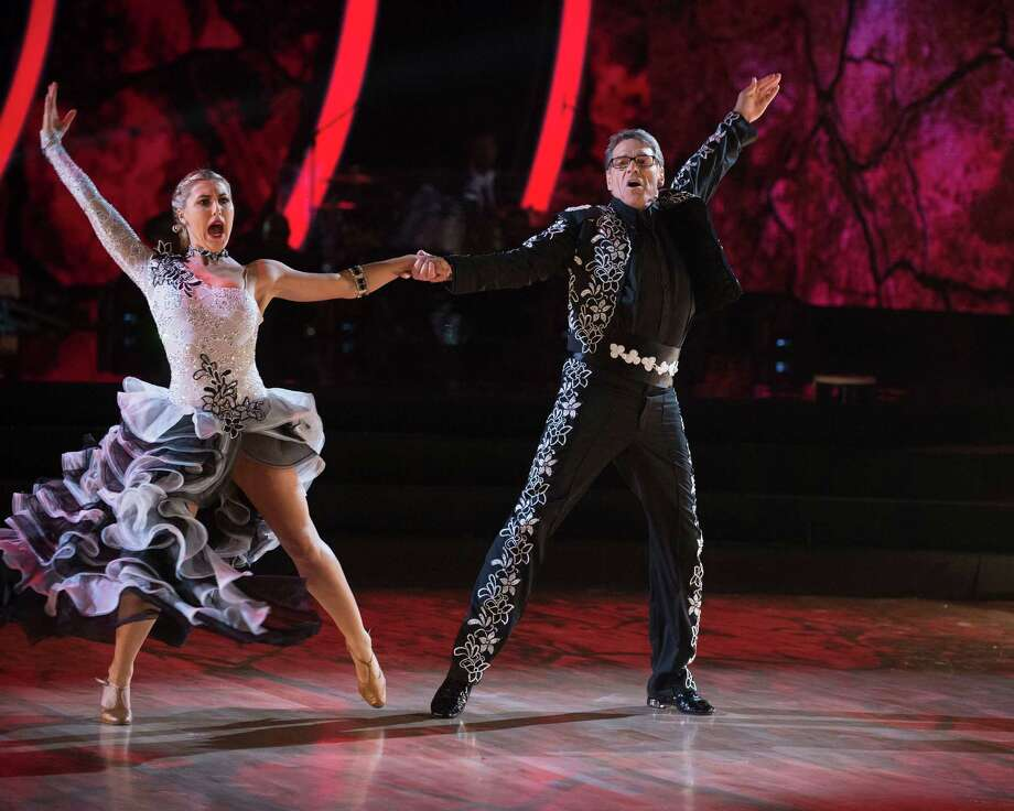 "Former governor of Texas, Rick Perry, dances the paso doble with partner Emma Slater during the live Sept. 26, 2016, broadcast of ""Dancing with the Stars"" on ABC. Photo: Courtesy ABC / © 2016 American Broadcasting Companies, Inc. All rights reserved."