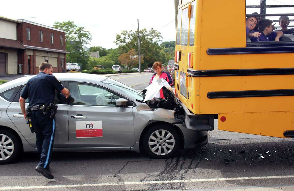 a silver nissan sentra rear ended a school bus that had 28 eighth graders from a car crashed