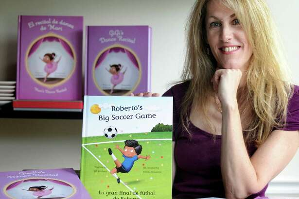 """Jill Barletti, of Danbury, writes children's books that can be personalized depending on ethnicity and sexual orientation of parents. Her most recent book is """"The Big Soccer Game."""" Photo, Sept. 23, 2016."""