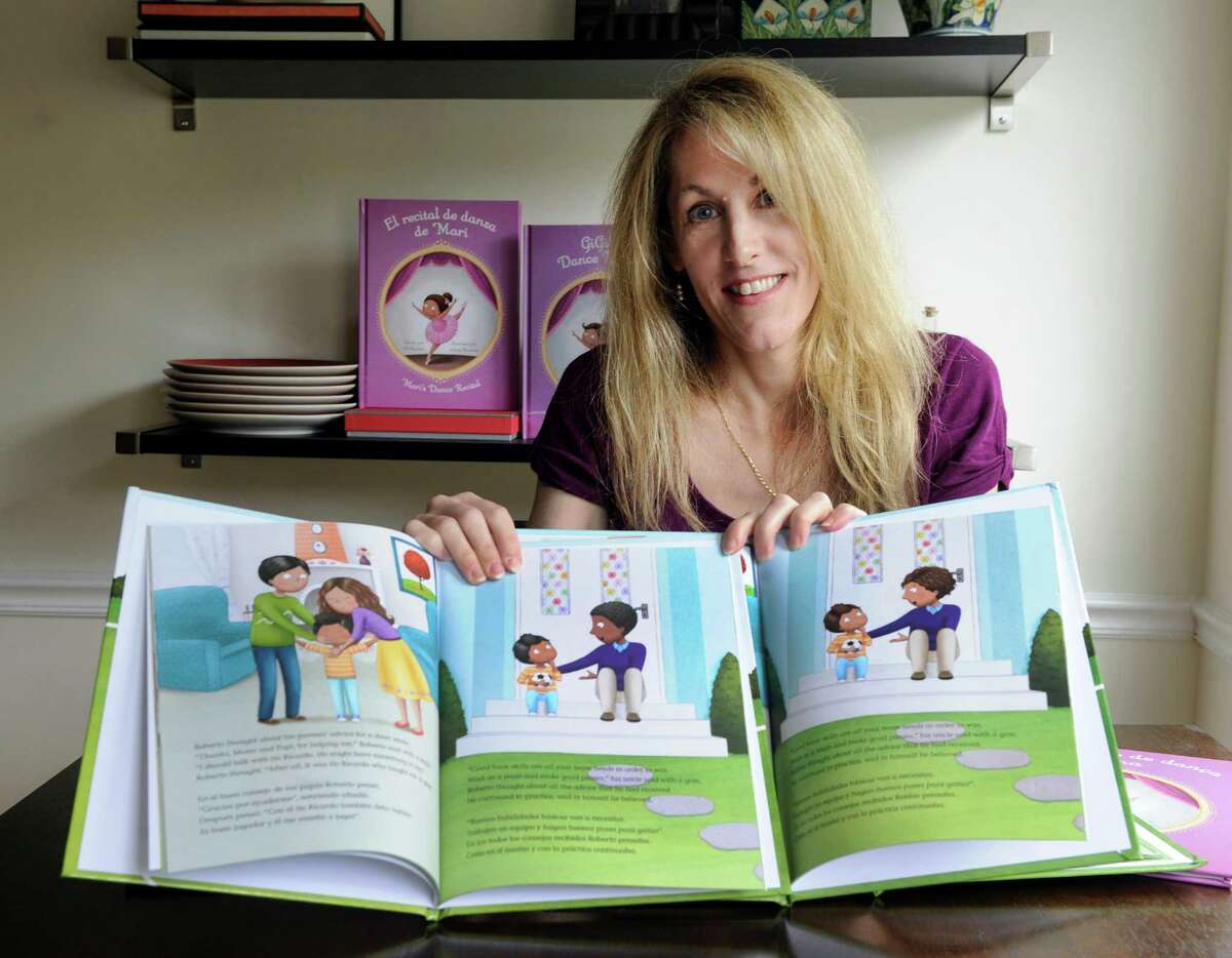 """Jill Barletti, of Danbury, writes children's books that can be personalized depending on ethnicity and sexual orientation of parents. Her most recent is """"The Big Soccer Game."""""""