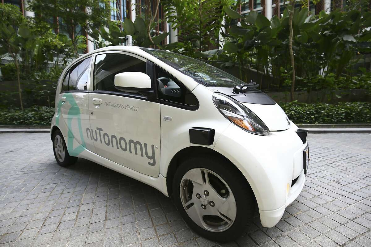 FILE - In this Wednesday, Aug. 24, 2016, file photo, an autonomous vehicle is parked for its test drive in Singapore. Autonomous vehicle software startup nuTonomy has made rides on its self-driving taxis available to the general public in Singapore for free, expanding a first-in-the world run that was initially invitation-only. (AP Photo/Yong Teck Lim, File)