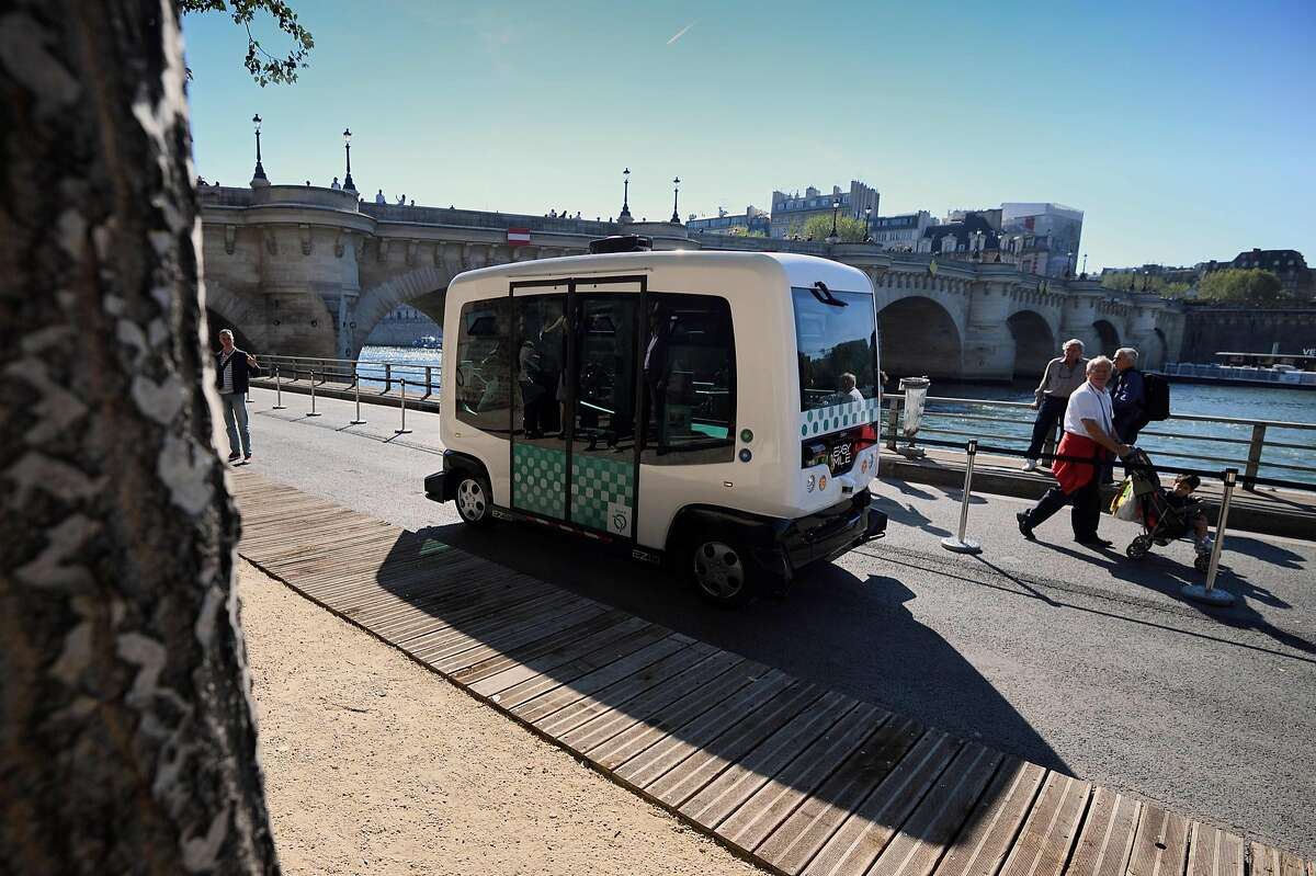 A French capital's transport authority RATP electric-powered driverless EZ10 minibus, able to carry up to 12 passengers, carries out its first test on the banks of the river Seine on September 24, 2016 in Paris. The RATP carries out its first test of a driverless minibus, in the hope that regular routes for the hi-tech vehicles will be up and running within two years. One of the self-driving shuttle buses, made by French hi-tech firm Easymile, run today along a special circuit in Paris on a pedestrianised street near the River Seine. / AFP PHOTO / ERIC FEFERBERGERIC FEFERBERG/AFP/Getty Images