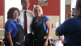 Malt House wait staff Gloria Ricondo, 70, left, and Maria Trevino, 28, (tilde over n), get their picture taken with U.S. Congressman Joaquin Castro, Tuesday, May 28, 2013.