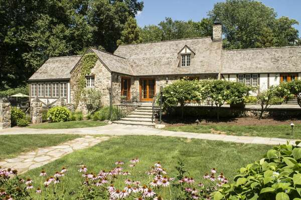 This New Canaan home at 102 Valley Road is on the market for $2,575,000 and features  four bedrooms and five bathrooms. A celebrity designer was brought in to detail this home, which includes seven fireplaces, cathedral celings, a gourmet kitchen, walk-in closets and a pool.