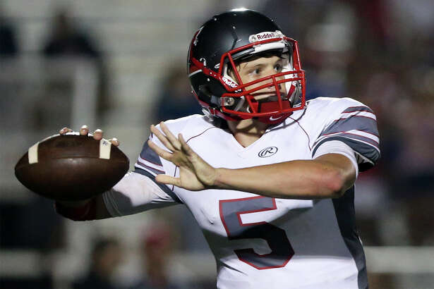 Lee quarterback Kyle Fuller looks to throw during the first half of their District 26-6A game with Johnson at Comalander Stadium on Sept. 24, 2015.