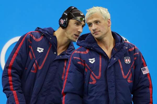 Ryan Lochte, second left, and Michael Phelps speak before the men's 4x200-meter freestyle relay during the Summer Olympics in Rio de Janeiro, Aug. 9, 2016.  (Doug Mills/The New York Times)  -- PART OF A COLLECTION OF PHOTOS FROM THE SUMMER OLYMPICS IN RIO DE JANEIRO FOR USE AS DESIRED IN YEAREND STORIES AND RECAPS OF 2016 --