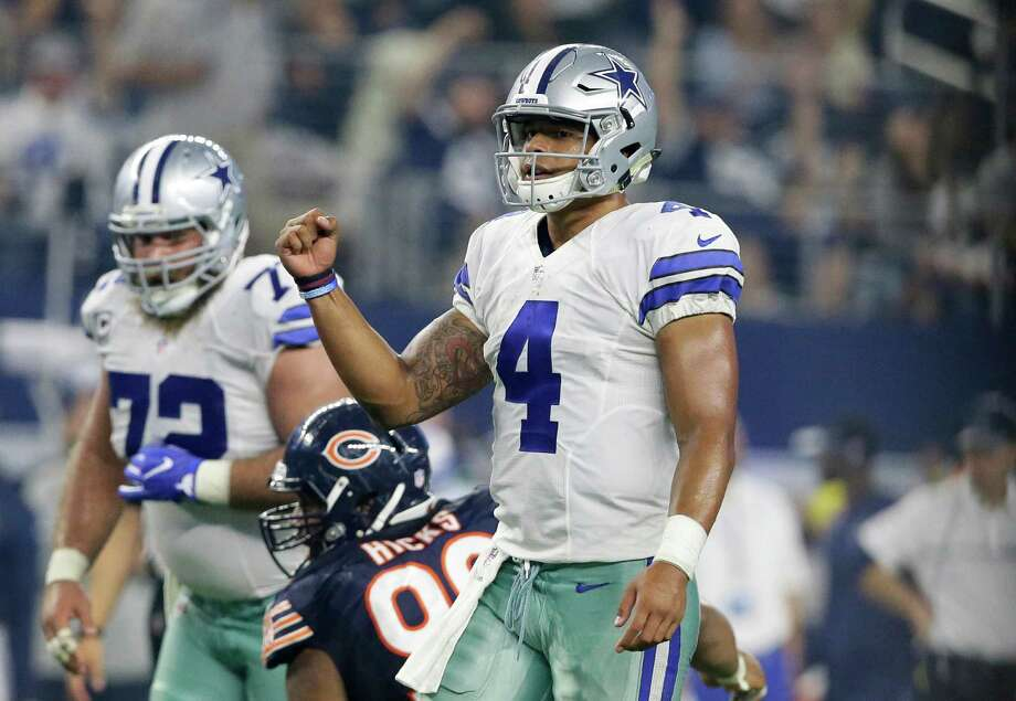Dallas Cowboys quarterback Dak Prescott (4) celebrates a touchdown catch by wide receiver Dez Bryant in the second half of an NFL football game against the Chicago Bears on Sunday, Sept. 25, 2016, in Arlington, Texas. (AP Photo/LM Otero) Photo: LM Otero, Associated Press / Copyright 2016 The Associated Press. All rights reserved.