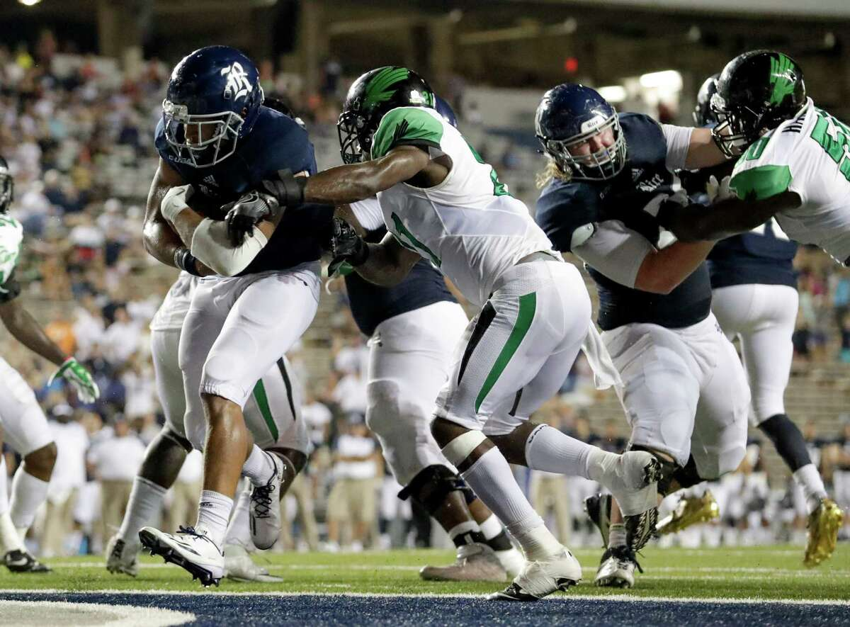 12. Rice (0-4) - Rice Owls running back Darik Dillard (1) rushes for a touchdown in the fourth quarter during the NCAA football game between the North Texas Mean Green and the Rice Owls at Rice Stadium in Houston, TX on Saturday, September 24, 2016. The Owls and the Mean Green are tied 28-28 at the end of regulation.
