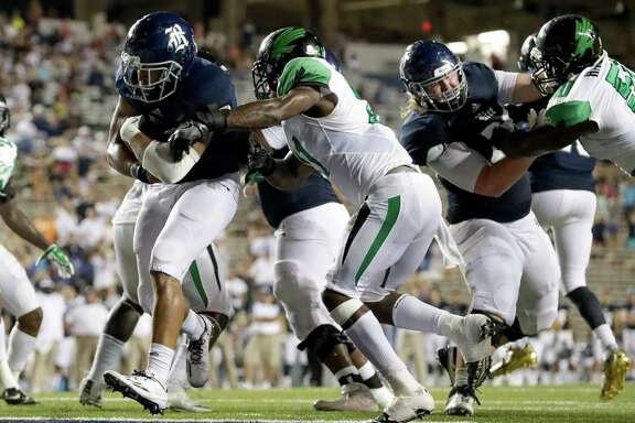Rice Owls running back Darik Dillard (1) rushes for a touchdown in the fourth quarter during the NCAA football game between the North Texas Mean Green and the Rice Owls at Rice Stadium in Houston, TX on Saturday, September 24, 2016.  The Owls and the Mean Green are tied 28-28 at the end of regulation.
