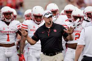 "FILE - In this Saturday, Sept. 24, 2016, file photo, Houston head coach Tom Herman runs drills with his team before an NCAA college football game against Texas State in San Marcos, Texas. After firing the most successful coach football coach in the history of the program, LSU needs a home run hire. ""Let's say there's a coach at Houston who may have a choice at Texas, Southern Cal or LSU,"" former LSU coach and Big Ten Network analysis Gerry DiNardo said, making a not so subtle reference to Herman. (AP Photo/Darren Abate, File)"