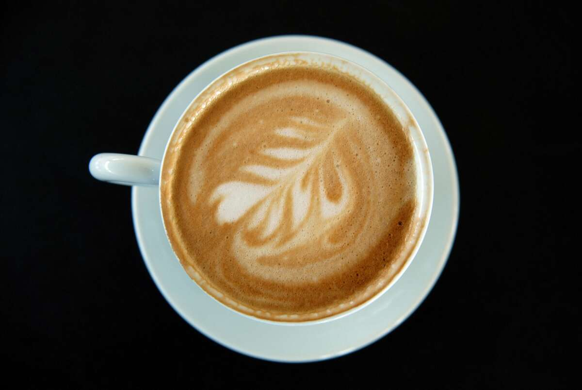 A cup of coffee - cafe latte - in a cafe.