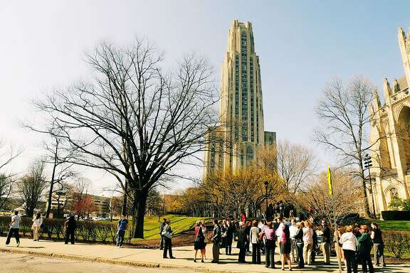 """The Cathedral of Learning stands tall in Oakland on the campus of the University of Pittsburgh, which is one school that has taken a stance against """"award displacement."""" (Darrell Sapp/Pittsburgh Post-Gazette/TNS)"""
