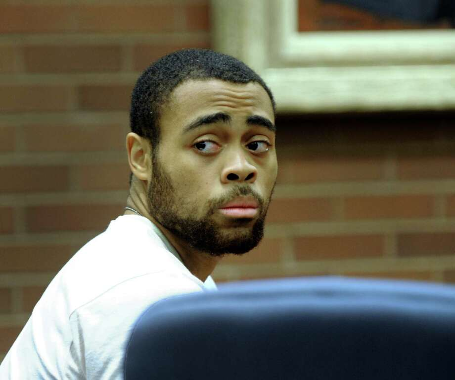 Emanuel Harris, charged with murder, represented by Attorney Dante Gallucci, appears in state Superior Court in Danbury Tuesday, Sept. 27, 2016, for the first day of jury selection in his trial. Photo: Carol Kaliff / Hearst Connecticut Media / The News-Times