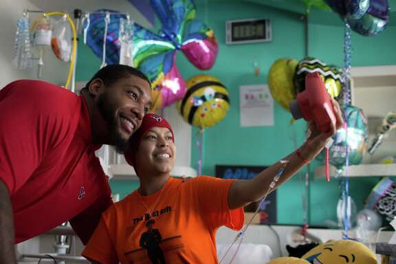 Texas defensive end Devon Still and Magaly Jimenez, 18, get together for a selfie in her hospital room at the Texas Children's Hospital. Still visited cancer patients at the hospital as a way to bring awareness about childhood cancer during Childhood Cancer Awareness Month, Tuesday, Sept. 27, 2016, in Houston.
